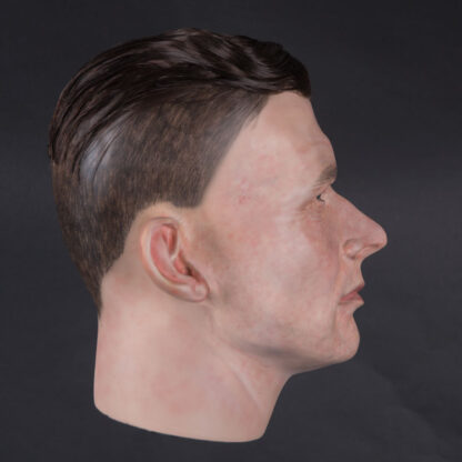 Airbrushed male mannequin head with glued hair